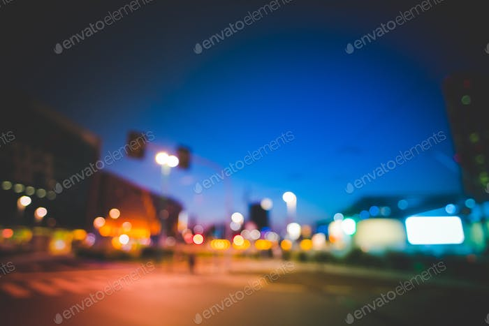 Intentionally blurred night view of the street of a metropolis d