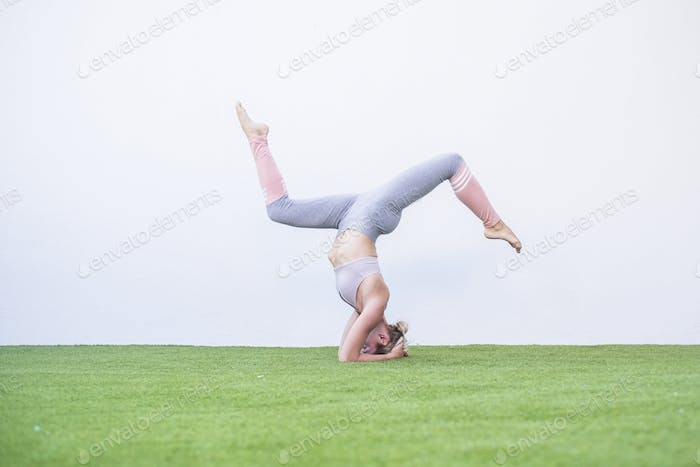 Perfect yoga pilates workout position for strong young lady