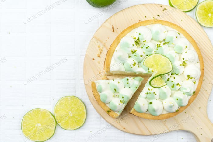 Key lime cheese tart with whipping cream on top