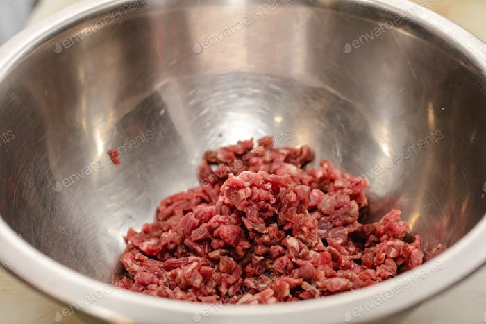 Chef preparing steak tartar of old cow sirloin with 40 days of maturation on restaurant