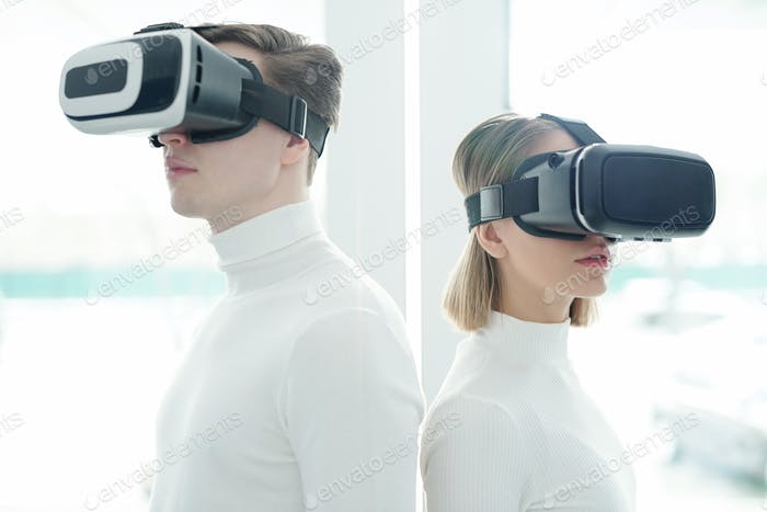 Young people in virtual reality goggles