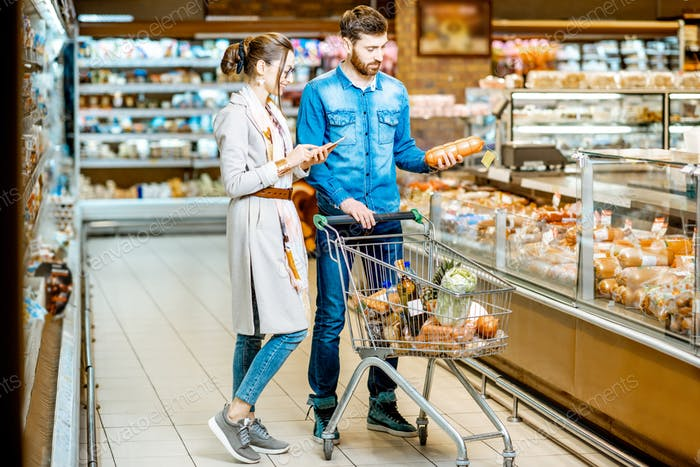 Couple buying food in the supermarket