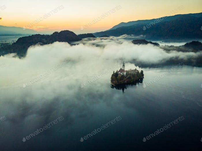 Bled castle on lake in foggy autumn morning,SLovenia