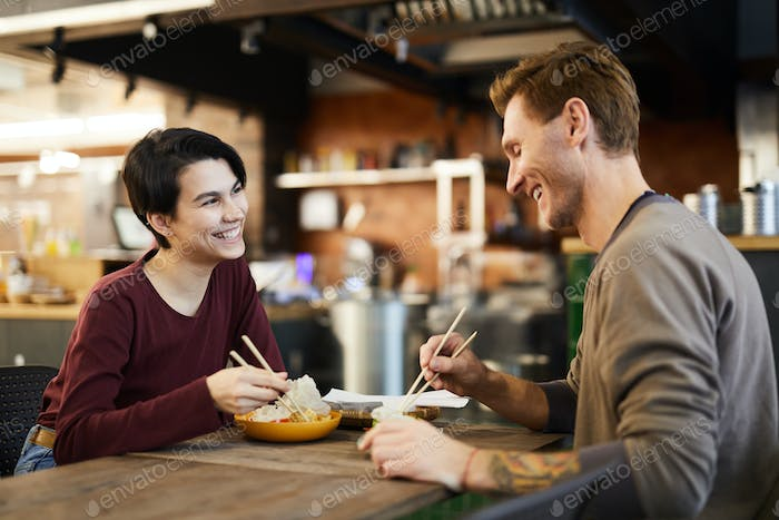 Cheerful Couple in Chinese Food Restaurant