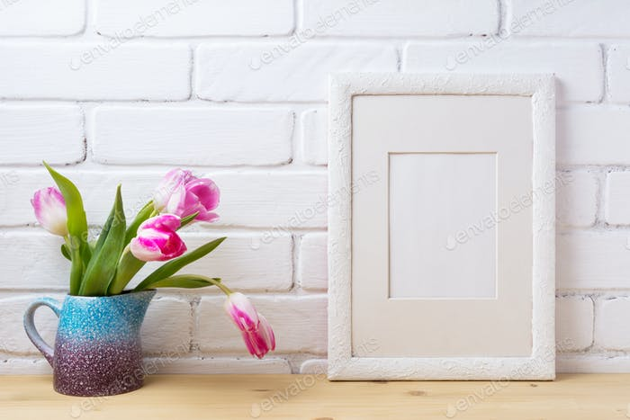 White frame mockup with pink tulip in blue pitcher