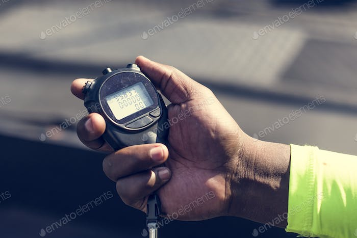 Closeup of hand holding stopwatch