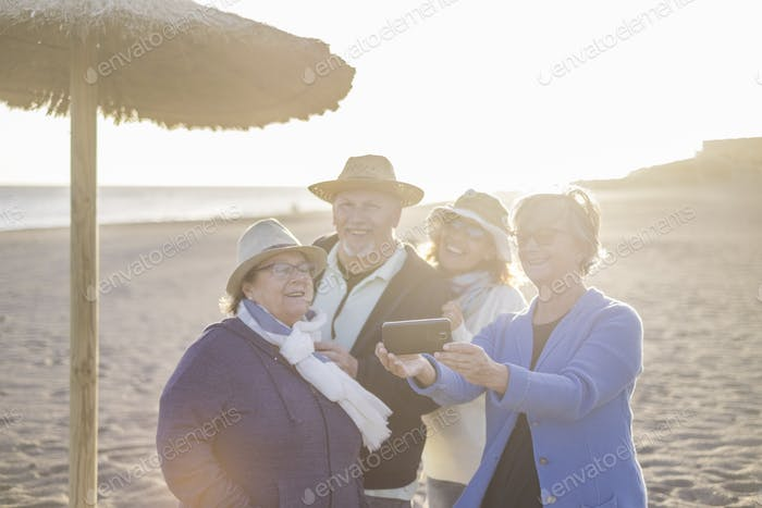 mixed ages caucasian group of four people three women and one man stay together