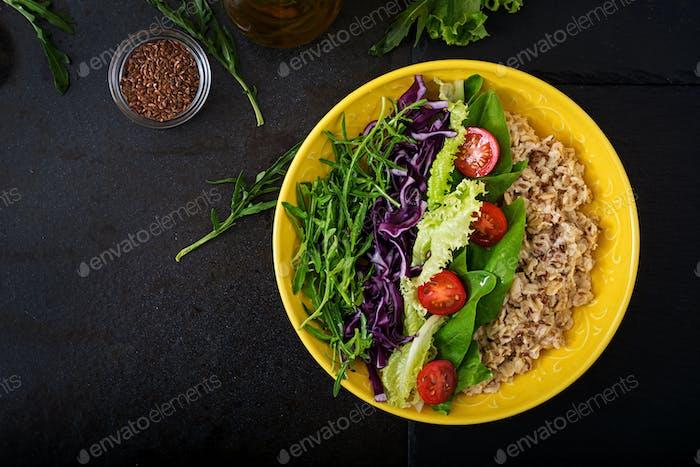 Diet menu. Healthy lifestyle. Oat porridge, egg and fresh vegetables