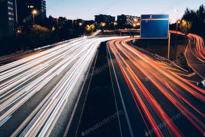 Traffic lights at night on road