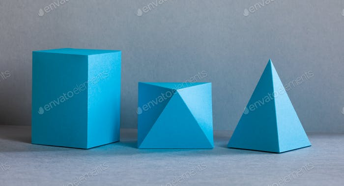 Blue color geometrical figures still life composition.