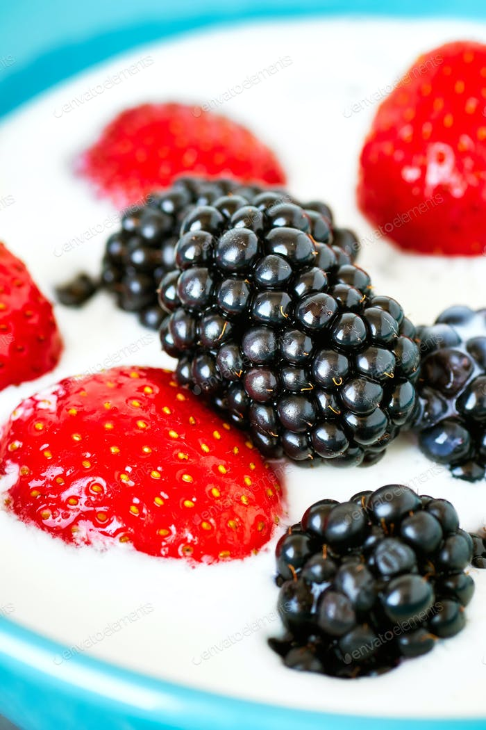 Blackberries and strawberries in yogurt.