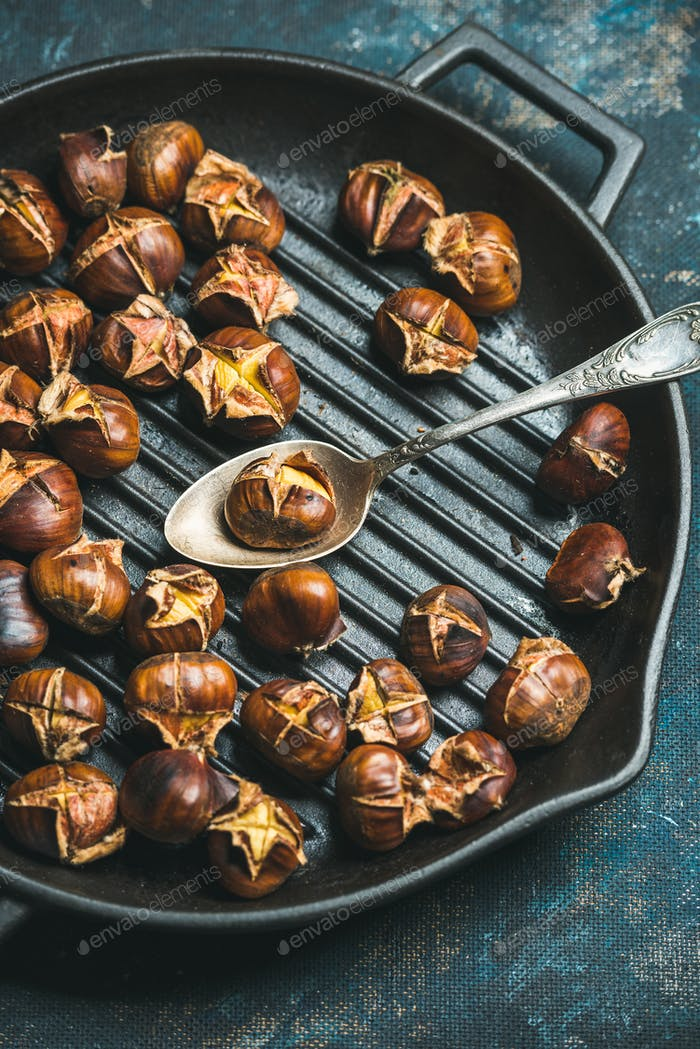 Close-up of roasted chestnuts and spoon