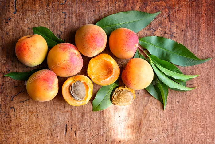 Ripe apricots on the old wooden background. Top view