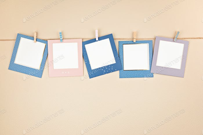 Mock up with colorful picture frames hanging on the rope with copy space for text and photos