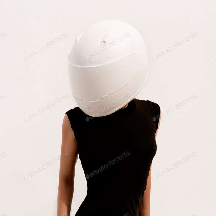 Model in a motorcycle helmet. Minimal art.