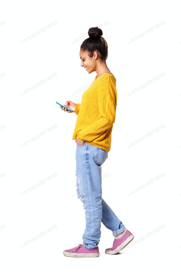 Relaxed young african woman using mobile phone