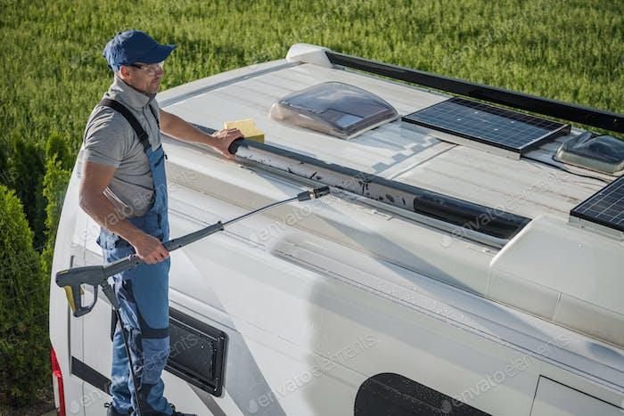 Smiling Caucasian Men Washing His Motorhome RV Camper Van