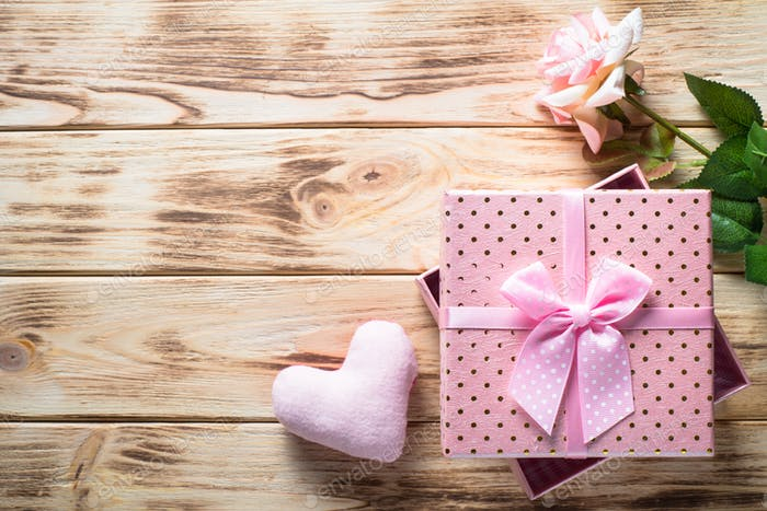 Present box on wooden table.