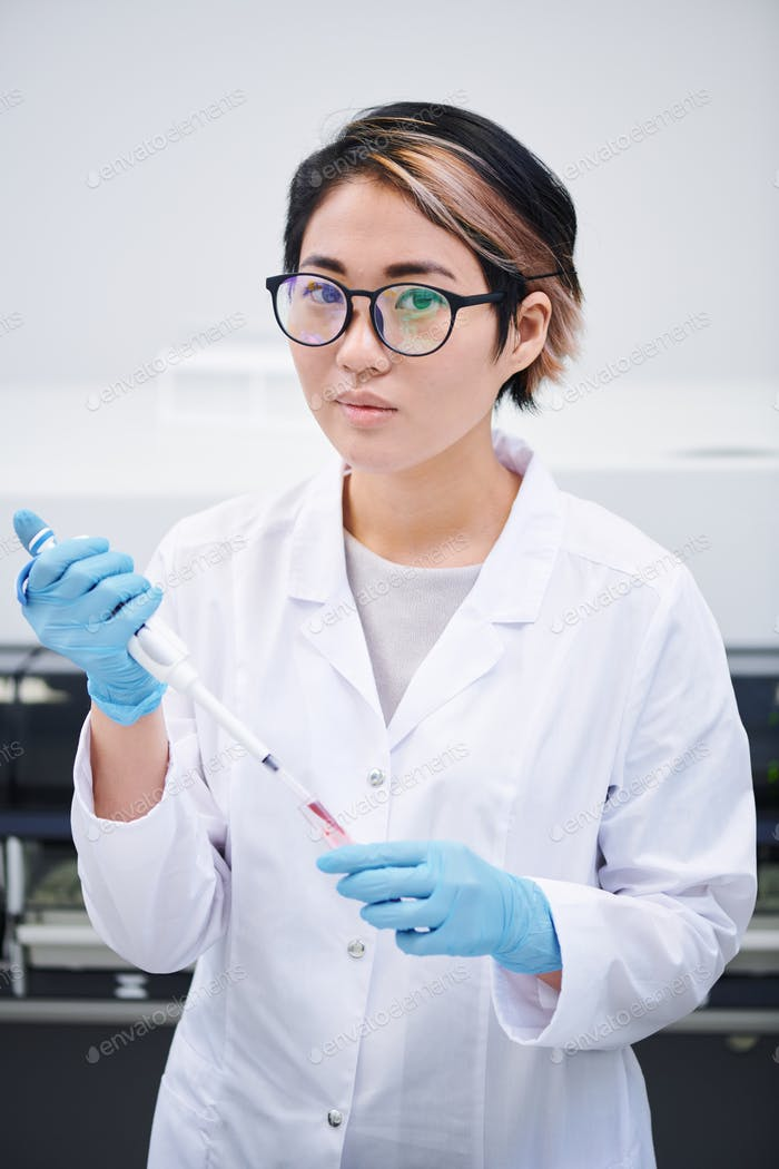 Young lab technician preparing sample for research