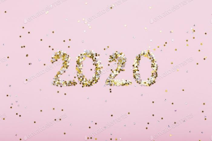 Big numbers of golden brilliants on pink