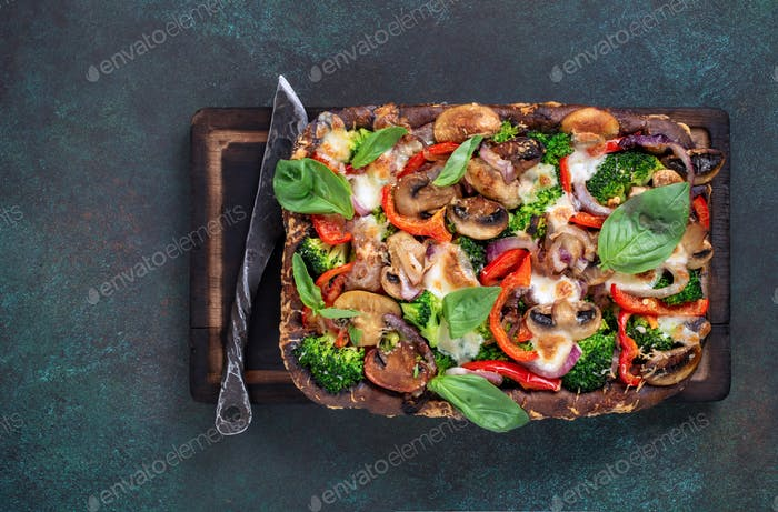 Pizza with broccoli and mushrooms