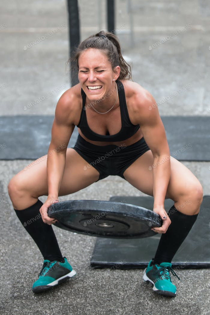 Woman lifting weights at a cross training competition