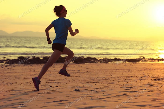 Running on sunset beach