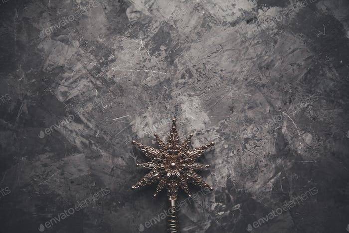 Christmas stars on gray background, selected focus