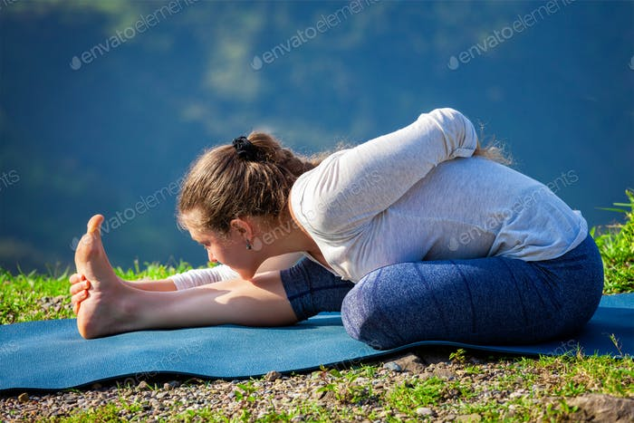 Woman doing yoga asana outdoors