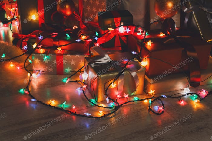 Christmas present and garland lights, holiday concept