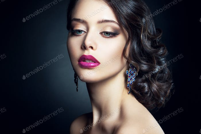 Close-up studio portrait of beautiful woman.