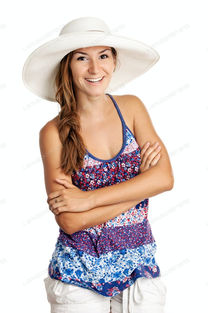 Pretty girl in summer clothing and wearing a hat