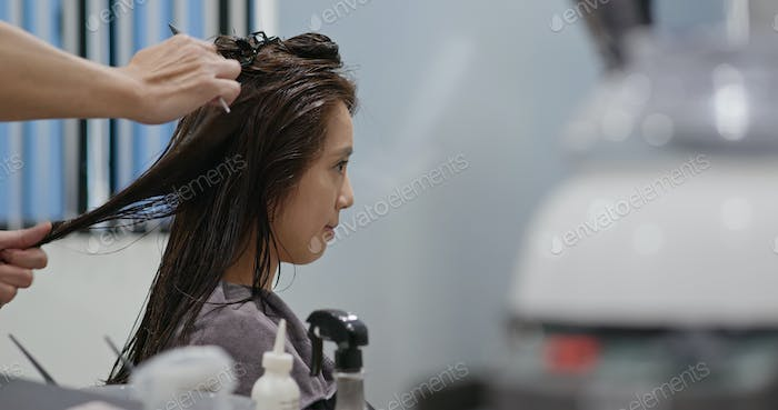 Woman making straight of the hair in salon