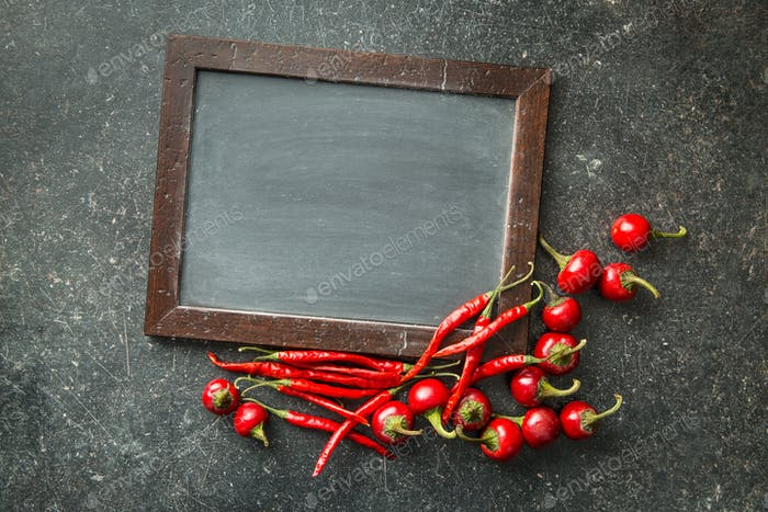 Chalkboard and red chili peppers.