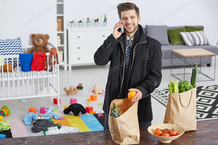Content father with shopping bags