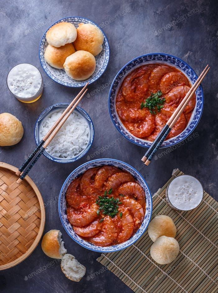 Huge shrimps in spicy chili sauce, singaporean cuisine
