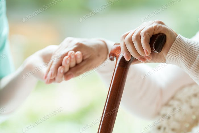 Elder person using walking cane