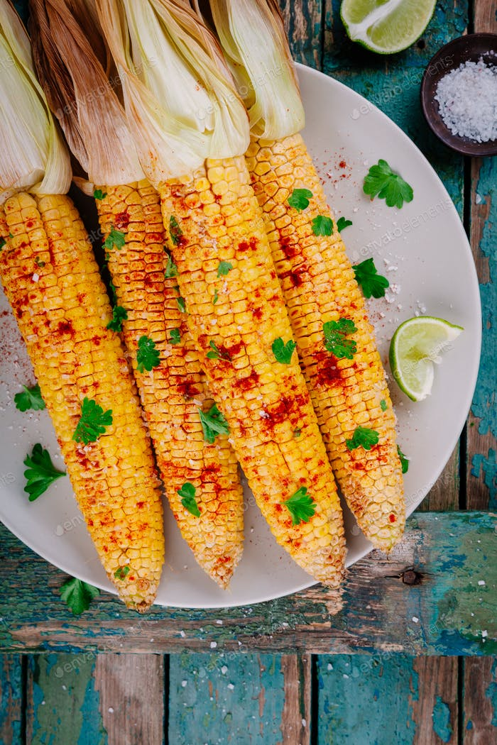 baked sweet corn cobs with herb butter and lime