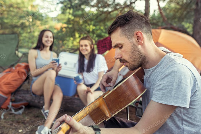 Thumbnail for Party, camping of men and women group at forest. They relaxing, singing a song