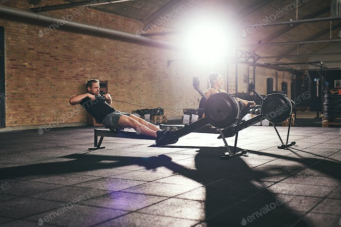 Two sportsmen in light gym working out