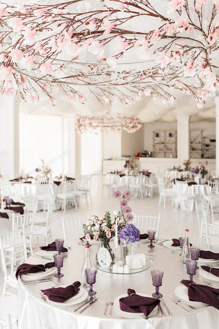 Photo of amazing wedding hall with floral decor