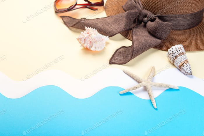 Hat, sunglasses and seashells on waves made from paper, horizontal copy space