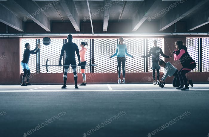 Group of diverse friends working out in town