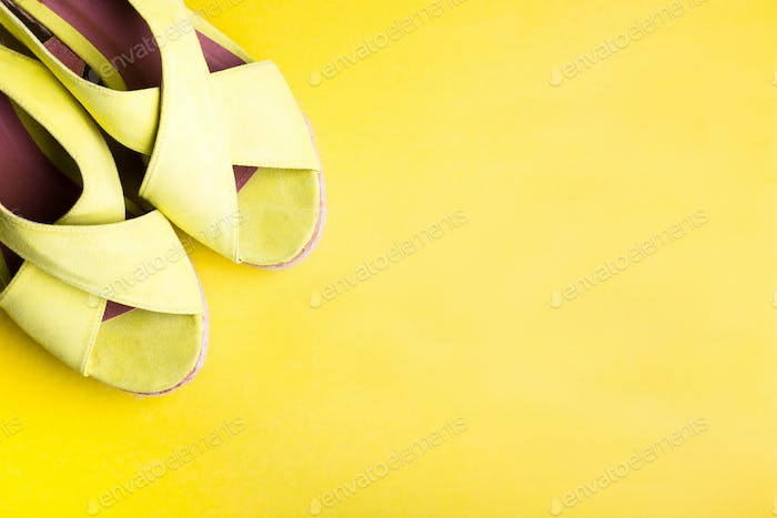Yellow Platform Sandals on Peper Yellow Background. Flat Lay.