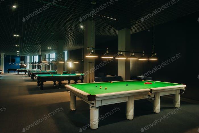 placing snooker balls on a green billiard table