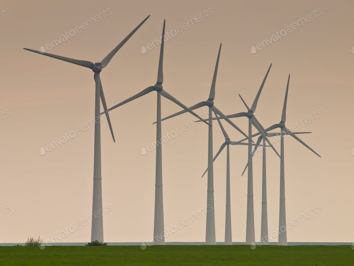 Row of windturbines during sunset