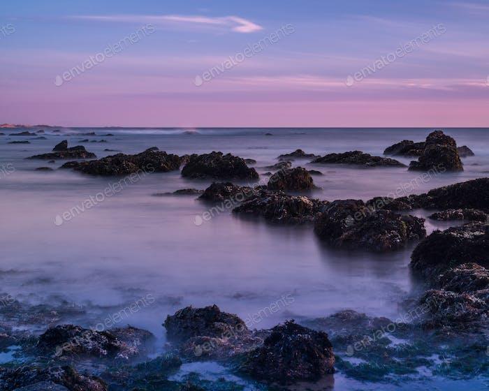 Tide pools at sunset; Pacific Ocean coastline, California; long exposure