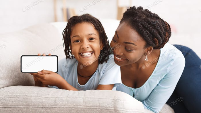 Black family showing blank phone screen for ad