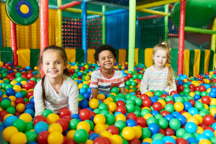 Three Cute Kids Playing in Ballpit