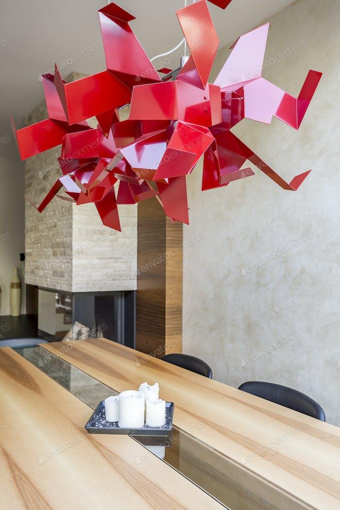 Unique chandelier above the table